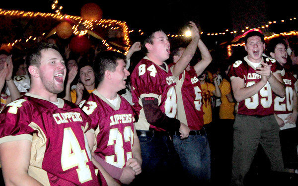 Newburyport: Members of the Newburyport High football team cheer on co-captain Dillon Guthro as he pumps up the student body in anticipation of their game with Amesbury on Thanksgiving which is held at World War Memorial Stadium this year. Bryan Eaton/Staff Photo