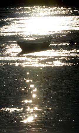 Amesbury: Late afternoon sun silhouettes a dory at Lowell's Boat Shop in Amesbury, the end of the boating season being near. Bryan Eaton/Staff Photo