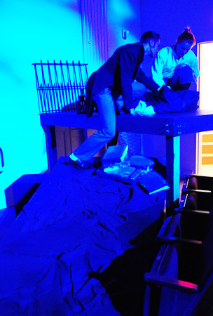 "Newburyport: John Gray, as Victor Frankenstein and Anna Moore as Hans Metz look over a body in the graveyard in the Newburyport High School play ""Frankenstein."" Bryan Eaton/Staff Photo"