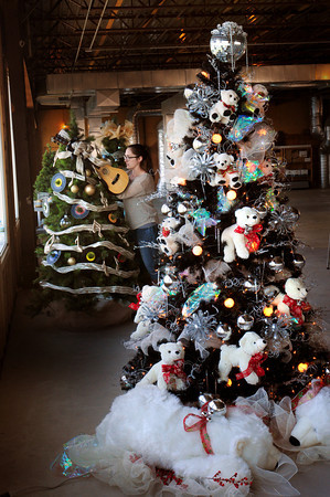 Salisbury: Marketing assistant at the Blue Ocean Music Hall Kim Kaminske of Byfield decorates their tree. The tree in front is decorated with a polar bear theme by Sue Nassar. Bryan Eaton/Staff Photo