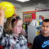Seabrook: Elyse Gaffney, 10, and LeBron Miller, 9, rub a balloon on their hair and then picked up pieces of tissue paper demonstrating static electricity. The two were in Kate Smith's fourth grade class at Seabrook Elementary School learning about electricity. Bryan Eaton/Staff Photo