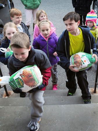 Newburyport: Children delivered three frozen turkeys to the Salvation Army yesterday afternoon to help with the organization's shortage and were met by Lt. Jeff Brunelle who thanked them for their effort. The youngsters, neighborhood friends in the Turkey Hill Road area, pooled their allowances to purchase the three birds. Bryan Eaton/Staff Photo