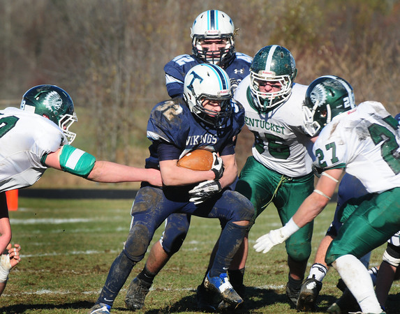 Byfield: Pentucket defenders put an end to Luke Boyles drive. Bryan Eaton/Staff Photo