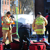 Amesbury: Firefighters who deal with hazardous waste suit up next to an air sensor near the command center on Oakland Street as they deal with a chemical spill at Arc Technologies. Bryan Eaton/Staff Photo