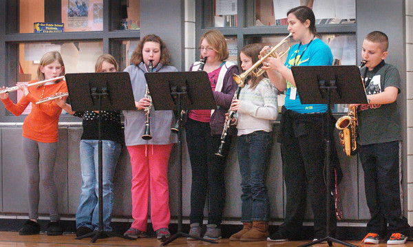 Salisbury: Some members of the Salisbury Elementary School band provided music for the Williams Bowl football game at the school on Wednesday morning. The game was held inside because of the heavy rain sweeping through the area. Bryan Eaton/Staff Photo