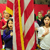 Amesbury: Cashman School fourth-graders lead the Amesbury school in the Pledge of Allegiance during a Veteran's Day assembly. Principal M. Louise Charette reminded the students that when they have the day off on Monday because of the holiday they think of those who served the country. Bryan Eaton/Staff Photo