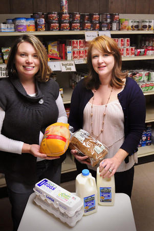 Amesbury: In addition to non-perishable food like canned tuna, Our Neighbor's Table Executive Director Lyndsey Haight, left, and treasurer Erica Brooks-Sayres are hoping for cash donations for the holiday season to provide perishables as needed for poultry, eggs, milk, bread and fresh vegetables. The Newburyport Five Cents Savings Bank, of which Brooks-Sayres is an assistant treasurer, is matching up to $15,000 in cash donations. Bryan Eaton/Staff Photo