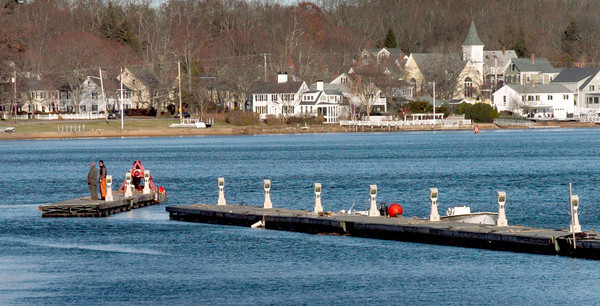 Amesbury: Most of the docks in the Merrimack River have been removed for the season and here a crew work on the last of them at the Marina at Hatter's Point in Amesbury on Wednesday afternoon. Bryan Eaton/Staff Photo