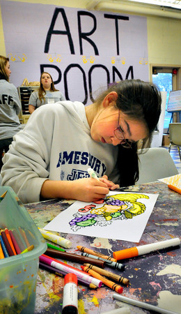 "Salisbury: Avarey Caron, 10, of Amesbury colors in an outline of a cornucopia, also known as ""horn of plenty,"" in a fall-themed coloring contest at the Boys and Girls Club. The winners get points to use in the club's store. Bryan Eaton/Staff Photo"