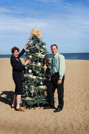 Salisbury: Anna Jaques Hospital President Delia O'Conner, left, and Wayne Capolupo, president of the Salisbury Beach Partnership, meet on the sands at Salisbury Beach to promote the upcoming Sea Festival of Trees which will benefit Anna Jaques Hospital and the Salisbury Beach Partnership. Bryan Eaton/Staff Photo
