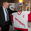 Salisbury: Legendary Amesbury High School hockey player, and later coach, Leo Dupere shows off a hockey jersey signed by well-wishers at an event to retire his number 13 at the Sylvan Street Grille in Salisbury last night. Bryan Eaton/Staff Photo