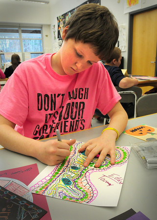 Salisbury: Eddie Tarmey, 12, creates designs around his full name of Edward in Amy Merluzzi's art class at Salisbury Elementary School on Tuesday. The children were working on abstract line design based on the spelling of their names. Bryan Eaton/Staff Photo