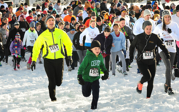BRYAN EATON/ Staff Photo. People of all ages headed out in the snow to run the 5K race.