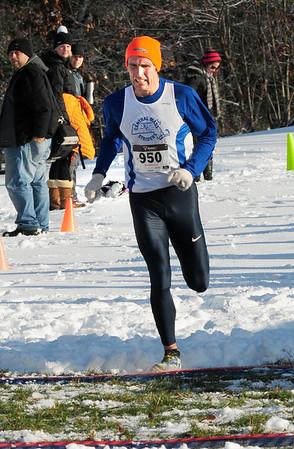 BRYAN EATON/ Staff Photo. Maudslay Turkey Trot winner Nate Jenkins of North Andover crosses the finish line.