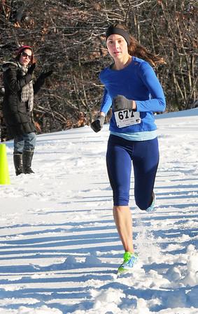 BRYAN EATON/ Staff Photo. Newburyport native Victoria Barnaby, now of East Boston, is the women's winner in the Maudslay Turkey Trot.