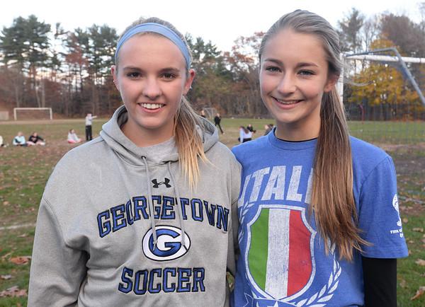 BRYAN EATON/ Staff Photo. Georgetown's Jensena Moner, left, and Jenny Migliacco.