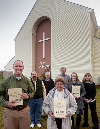 BRYAN EATON/ Staff Photo. Members of the Visions of Hope book, from left, Pastor Pete Balentine, Joe Marfongelli, Bob Campbell, Muriel Cummings, Dennis Gill, Abigail Pietrantonio and Willow Tervo.