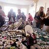 Jim Vaiknoras/Staff photo Shopper hunt for bargins at the Village of Churches fair in Amesbury.