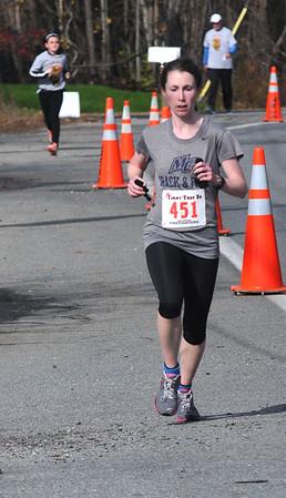 Jim Vaiknoras/Staff photo Rebecca Healey wins the 4th ANNUAL TIMMY TROT 5K in Salisbury.