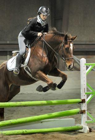 BRYAN EATON/Staff Photo. Alexandra Ferris of Ipswich makes a jump.