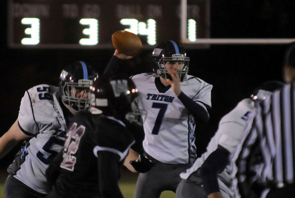 JIM VAIKNORAS/Staff photo Triton's Justin Cashman looks down field for a receive rduring the Viking game at Weston Friday night.