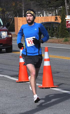 Jim Vaiknoras/Staff photo Chris Healey wins the 4th ANNUAL TIMMY TROT 5K in Salisbury.