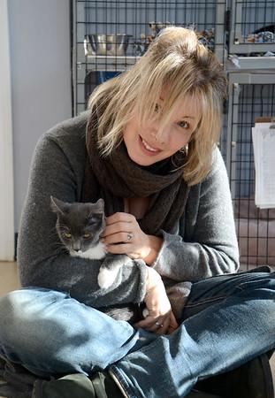 JIM VAIKNORAS/Staff photo Volunteer Jillian Overholser hold Starbuck at  the Merrimack Valley Feline Rescue Society in Salisbury.