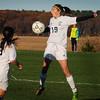 BRYAN EATON/ Staff Photo. Triton's Meredith Wilcox deflects the ball by a Shawsheen kick.