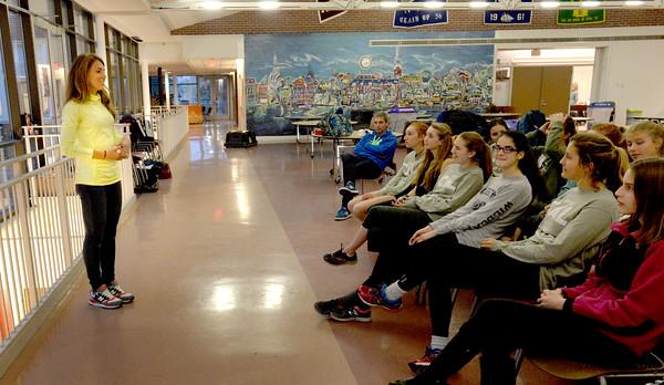 BRYAN EATON/Staff Photo. Olympic hopeful Cory McGee speaks to the Newburyport High girls cross country team.