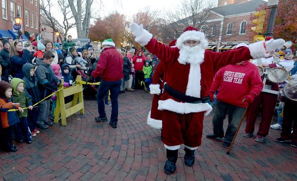 JIM VAIKNORAS/Staff photo Santa greets his fans in Market Square in Newburyport.