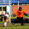 JIM VAIKNORAS/Staff photo Triton's Sofia DeSimone scores on Ipswich's Sydney Pignone Friday. The Vikings won the game 1-0.