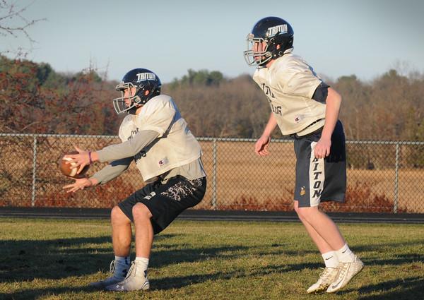 BRYAN EATON/Staff Photo. Triton quarterback Lewi L'Heureux and Liam Spillane, right.
