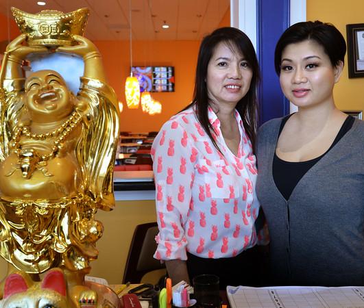 BRYAN EATON/Staff Photo. Vietnamese immigrants Nancy Lam, left, and her daughter, Krysteen Vo own Fancy Nails and Spa in Newburyport.