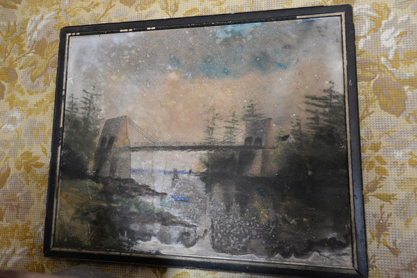 BRYAN EATON/Staff photo. A painting of the Chain Bridge.