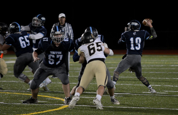 JIM VAIKNORAS/Staff photo Triton's Lewi L'Heureux throws a pass against  Bishop Fenwick at Triton Friday.