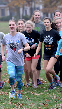 BRYAN EATON/Staff photo. Newburyport senior captain Alex Mackie, left, leads the pack as they practice at Maudslay State Park.