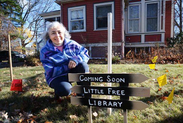 """BRYAN EATON/Staff photo. Katie Johnson's husband Chuck is building a free """"little library"""" outside their Amesbury home at 237 Elm Street at Goss Avenue."""