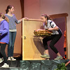 """BRYAN EATON/Staff photo. The Theater Workshop at Newbury Elementary School puts on """"Christmas in the Woods."""" Frankie Sullivan as the """"Rabbit"""" lets in Maggie Moffett as """"Owl"""" and Chloe Connors as """"Kanga."""""""