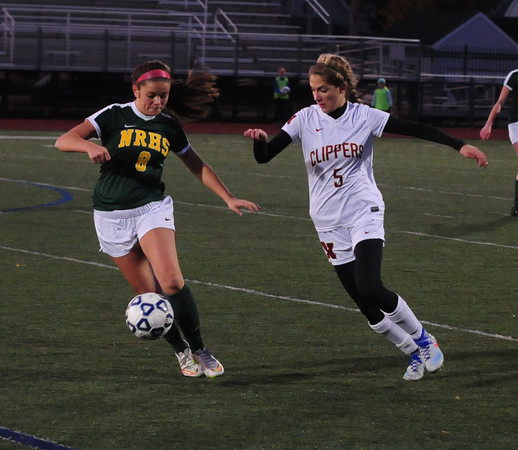 JIM VAIKNORAS/Staff photo Newburport's Amelia Kroshwitz fights for the ball with North Reading's Alyssia Prusik at the Manning Field in Lynn Saturday night.