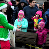 JIM VAIKNORAS/Staff photo Madison  Schmidt of Newburyport gives out candy canes dressed as an elf at the annual tree lighting in Market Square In Newburyport Sunday.