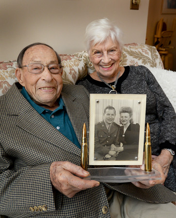 BRYAN EATON/Staff Photo. Newburyport native Al Hirsch, who turns 100 this month, and Pauline have been married 71 years. The two met in England during World War II. They hold an engagement photo.