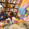 JIM VAIKNORAS/Staff photo Nella Snyder, 6, and her mom Heidi check out some of the items at The Dragon's Nest in Newburyport Friday.