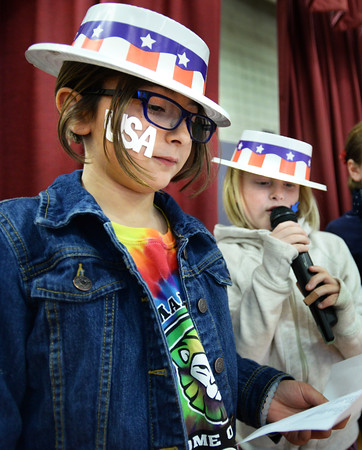 BRYAN EATON/Staff photo. Cashman Elementary School students Sophia Rodriguez, left, and Ruby Edmond, both 9, announce to to fellow students the voting procedure as they get ready to cast their ballots after lunch on Monday. The girls and the rest of the student council at the Amesbury school ran the mock election with the resulting tally, Clinton, 329; Trump, 99 and Stein, 1.