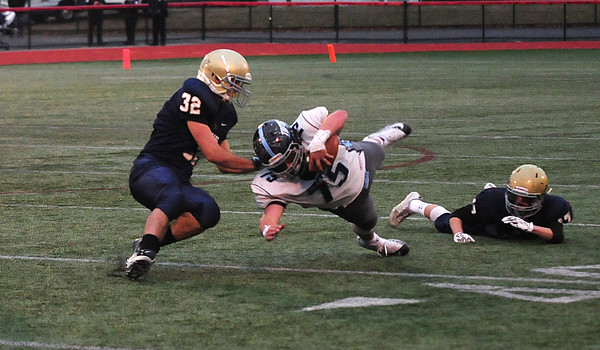 JIM VAIKNORAS/Staff photo Triton's John Falasca dives for a first down during the Viking's game against Hanover at Rocky Marciano Stadium in Brockton Saturday.