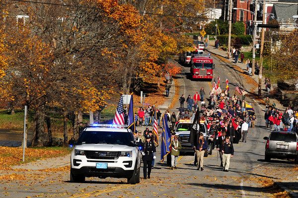 JIM VAIKNORAS/Staff photo The Amesbury's Veterans Day parade makes it;s way up Main Street towards Amesbury Middle School for the annual service Friday.