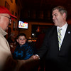 BRYAN EATON/Staff photo. Newburyport City Council president Thomas O'Brien shakes state Rep. James Kelcourse as he greeted supporters at the Ale House in Amesbury on Tuesday night.