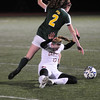 JIM VAIKNORAS/Staff photo Newburyport's Anna Hickman collides with  North Reading's Juliette Nadeau at the Manning Field in Lynn Saturday night.