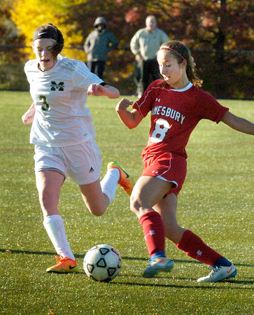 BRYAN EATON/Staff photo. Amesbury's Ashley Pettet moves the ball past a Matignon player.
