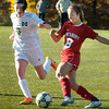 BRYAN EATON/Staff photo. Amesbury's Ashley Pettet moves the ball past a Matignon player.