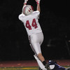 JIM VAIKNORAS/Staff photo Amesbury's Kyle Martin huals in a long touchdown pass during the Indian's game  at Shawsheen  Tech in Billerica Saturday night.